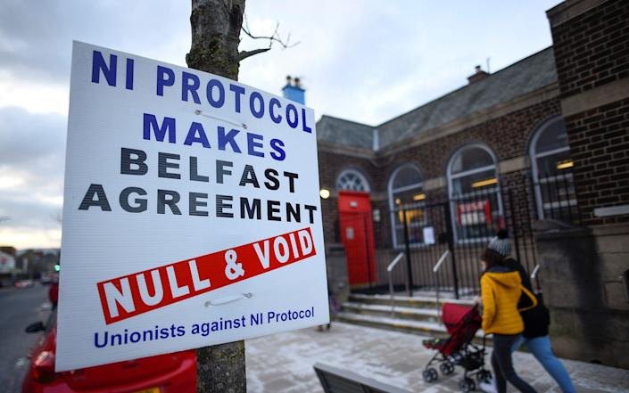 A sign is seen with a message against the Brexit border checks in relation to the Northern Ireland protocol in Larne - CLODAGH KILCOYNE/REUTERS