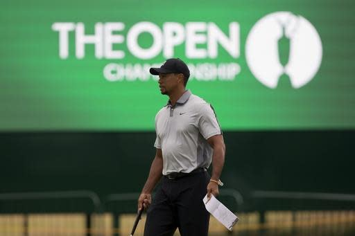 Tiger Woods of the US walks on the 2nd green during a practice round at the Royal Liverpool Golf Club prior to the start of the British Open Golf Championship, in Hoylake, England, Saturday, July 12, 2014. The 2014 Open Championship starts on Thursday, July 17. (AP Photo/Jon Super)
