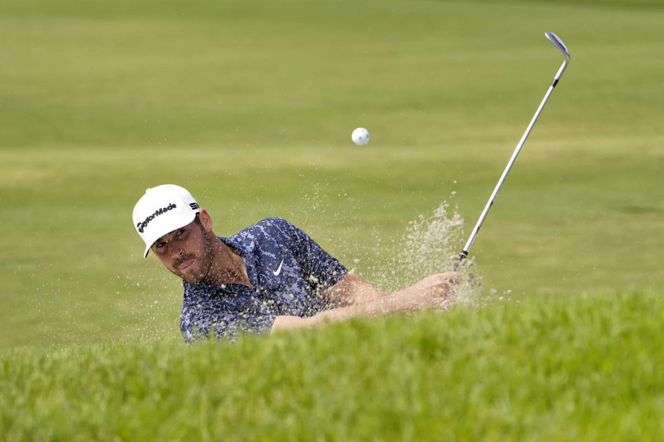Matthew Wolff plays a shot from a bunker on the tenth hole during the third round of the U.S. Open Golf Championship, Saturday, June 19, 2021, at Torrey Pines Golf Course in San Diego. (AP Photo/Jae C. Hong)