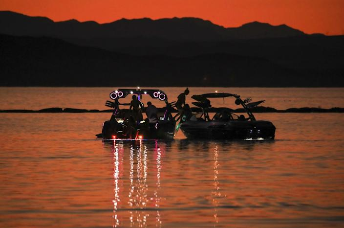 Weekend boaters wait on the water for a launch ramp