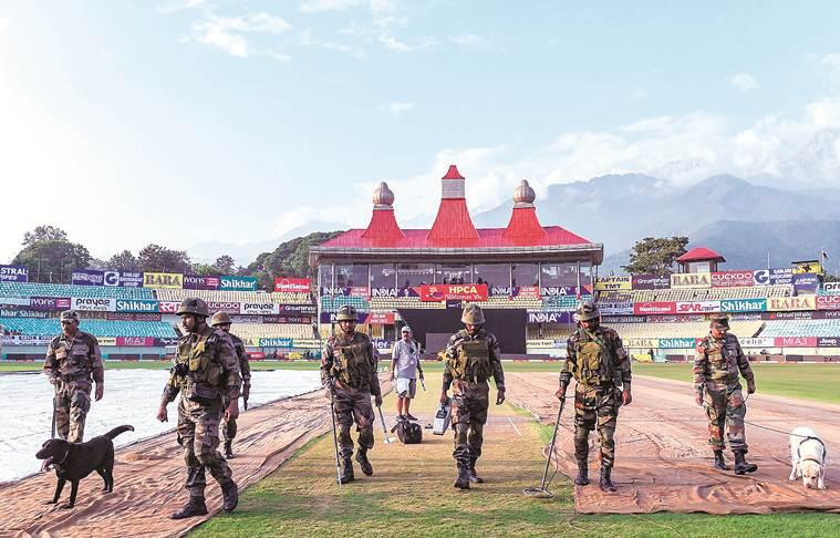 A bomb disposal squad scans the playing field in Dharamshala on Saturday. India face South Africa in the first T20I here on Sunday. (PTI)