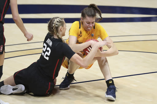 Stanford's Cameron Brink (22) fights for the ball against California's Sela Heide (32) during the first half of an NCAA college basketball game, Sunday, Dec. 13, 2020, in Berkeley, Calif. (AP Photo/Jed Jacobsohn)