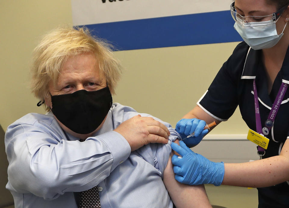 Britain's Prime Minister Boris Johnson receives the first dose of the AstraZeneca vaccine administered by nurse and Clinical Pod Lead, Lily Harrington at St. Thomas' Hospital in London, Friday, March 19, 2021. Johnson is one of several politicians across Europe, including French Prime Minister Jean Castex, getting a shot of the AstraZeneca vaccine on Friday. (AP Photo/Frank Augstein, Pool)