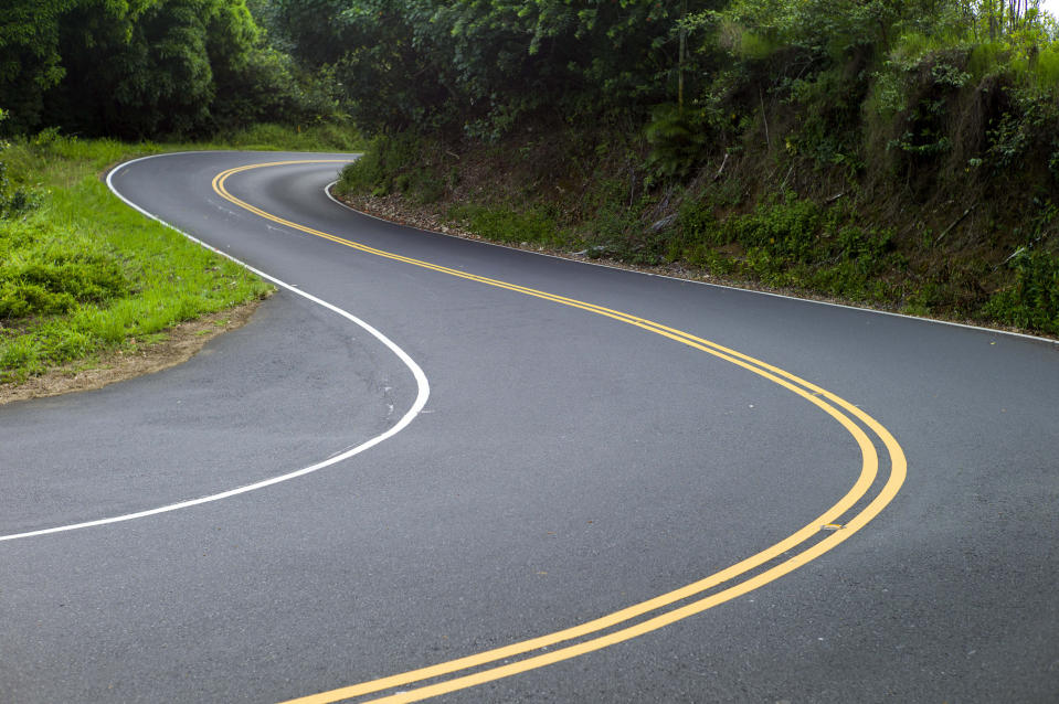 FILE- In this Sept. 24, 2014, file photo, is the curvy Hana Highway in Hana, Hawaii. So many tourists are flocking to Maui now that coronavirus pandemic concerns have eased in the United States that islanders are feeling overwhelmed and Maui's mayor is begging airlines to cut back on the number of people they fly to the island. (AP Photo/Marco Garcia, File)
