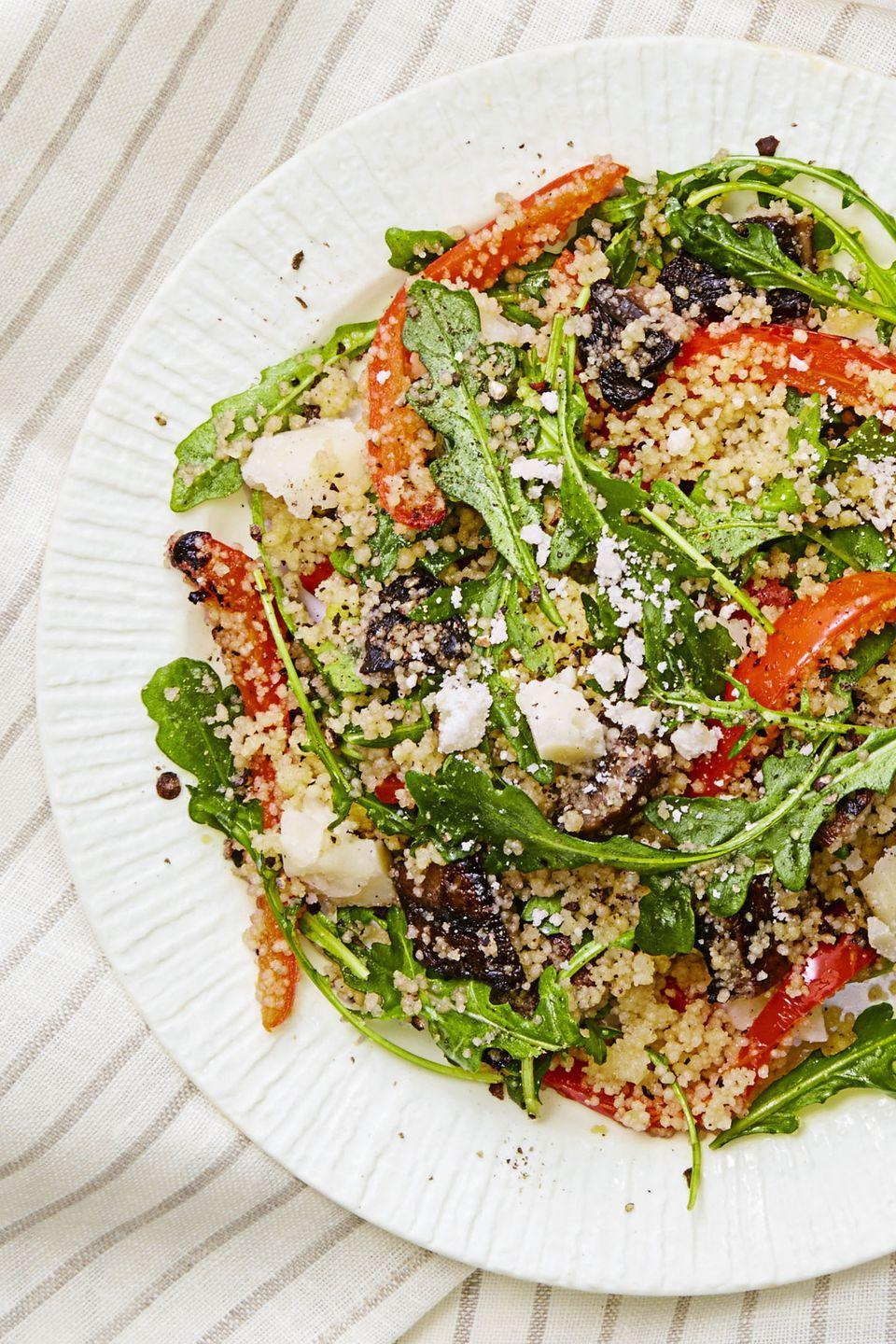 """<p>Meaty portobello mushrooms, grilled red peppers, and chunks of Pecorino make this meatless salad a satisfying supper.</p><p><em><a href=""""https://www.goodhousekeeping.com/food-recipes/easy/a33405/grilled-veggie-couscous-salad/"""" rel=""""nofollow noopener"""" target=""""_blank"""" data-ylk=""""slk:Get the recipe for Grilled Veggie Couscous Salad »"""" class=""""link rapid-noclick-resp"""">Get the recipe for Grilled Veggie Couscous Salad »</a></em></p>"""
