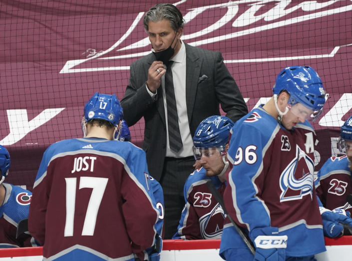 Colorado Avalanche head coach Jared Bednar, top, directs his players during a timeout against the St. Louis Blues in the second period of Game 1 of an NHL hockey Stanley Cup first-round playoff series Monday, May 17, 2021, in Denver. (AP Photo/David Zalubowski)