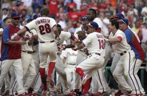 Philadelphia Phillies' Kevin Frandsen (28) crosses the plate after he hit a solo home run against the New York Mets in the ninth inning of a baseball game Saturday, June 22, 2013, in Philadelphia. The Phillies won 8-7. (AP Photo/H. Rumph Jr)