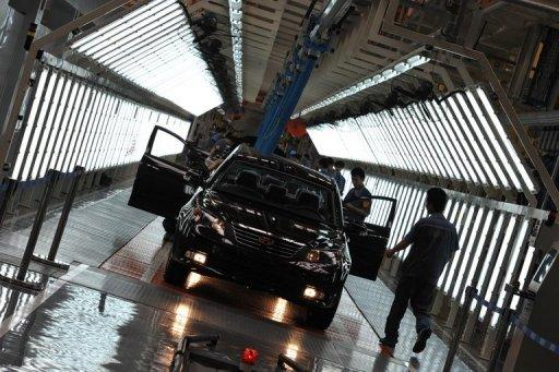 Workers build a car on an assembly line in China's Zhejiang province. China's manufacturing activity contracted at its slowest pace in five months in July, an independent survey showed Tuesday, indicating that Beijing's easing measures were beginning to take effect