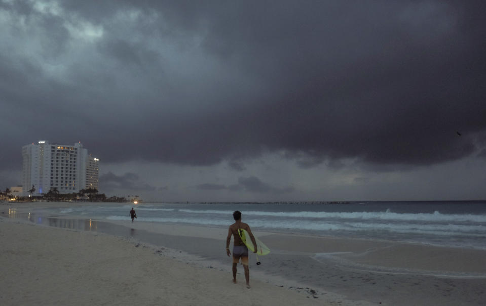 Clouds gather over Playa Gaviota Azul as Tropical Storm Zeta approaches Cancun, Mexico, early Monday morning, Oct. 26, 2020. A strengthening Tropical Storm Zeta is expected to become a hurricane Monday as it heads toward the eastern end of Mexico's resort-dotted Yucatan Peninsula and then likely move on for a possible landfall on the central U.S. Gulf Coast at midweek. (AP Photo/Victor Ruiz Garcia)