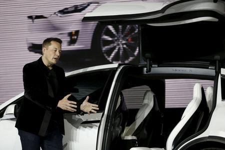 FILE PHOTO: Tesla Motors CEO Elon Musk introduces the falcon wing door on the Model X electric sports-utility vehicles during a presentation in Fremont, California September 29, 2015.  REUTERS/Stephen Lam/File Photo