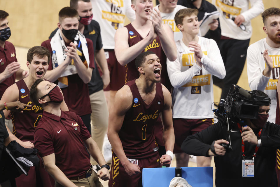 Loyola Chicago celebrates after a win against Illinois in the second round of the 2021 men's tournament on March 21. (Joe Robbins/NCAA Photos via Getty Images)