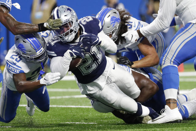 Dallas Cowboys running back Ezekiel Elliott (21) falls into the end zone for a 1-yard touchdown run during the first half of an NFL football game against the Detroit Lions, Sunday, Nov. 17, 2019, in Detroit. (AP Photo/Rick Osentoski)
