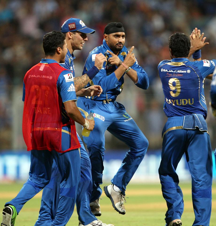Mumbai Indians bowler Harbhajan Singh breaks into Gangnam Style dance after getting the wicket of Chris Gayle during the match between Mumbai Indians and Royal Challengers Bangalore at Wankhede Stadium, Mumbai on April 27, 2013. (Photo: IANS)