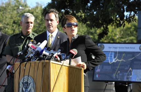 U.S. attorney Laura Duffy speaks during a news conference about a newly discovered drug smuggling tunnel as William Sherman (C), San Diego Special Agent in Charge Drug Enforcement Administration and Paul Beeson, Chief Patrol Agent, San Diego Sector, U.S. Border Patrol look on, in the Otay Mesa area of San Diego, California October 31, 2013. REUTERS/Denis Poroy