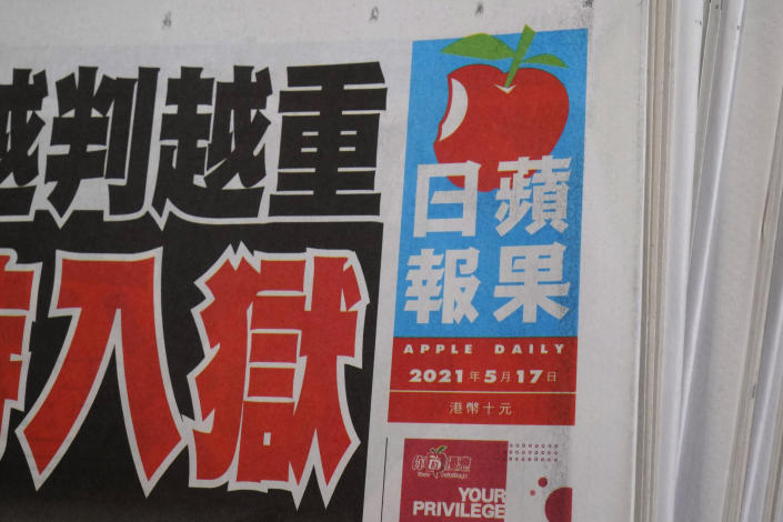 Copies of Apple Daily newspaper are displayed for sale at a newsstand in Hong Kong, Monday, May 17, 2021. The Hong Kong stock exchange on Monday halted the trading of Next Digital shares, days after authorities froze assets belonging to its founder Jimmy Lai. Next Digital said in a filing that it requested the halt after authorities announced that it had frozen Lai's assets Friday. Next Digital publishes pro-democracy tabloid Apple Daily, and the company was founded by Lai, its controlling shareholder. (AP Photo/Kin Cheung)