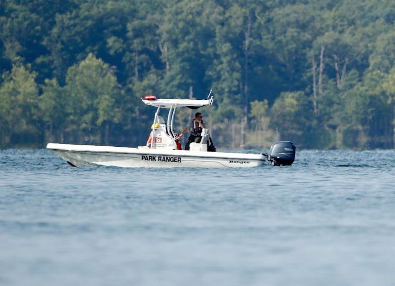 A park ranger patrols an area on Friday, near where a duck boat capsized in Table Rock Lake