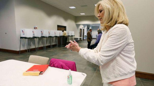 PHOTO: Republican Attorney General Lynn Fitch, rubs hand sanitizer on her hands after voting in the party presidential primary in Ridgeland, Miss., March 10, 2020. (Rogelio V. Solis/AP)