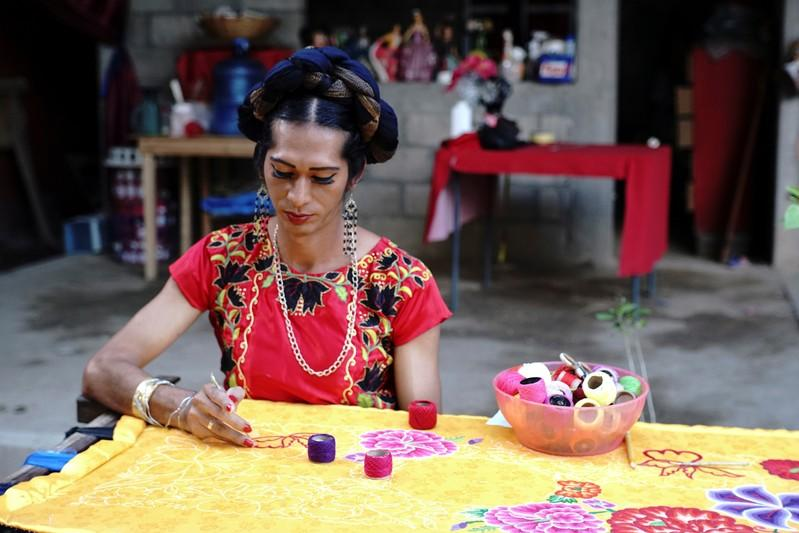 Estrella Vasquez, a muxe woman who features on the cover of Vogue magazine, paints a Huipil at her house in Juchitan
