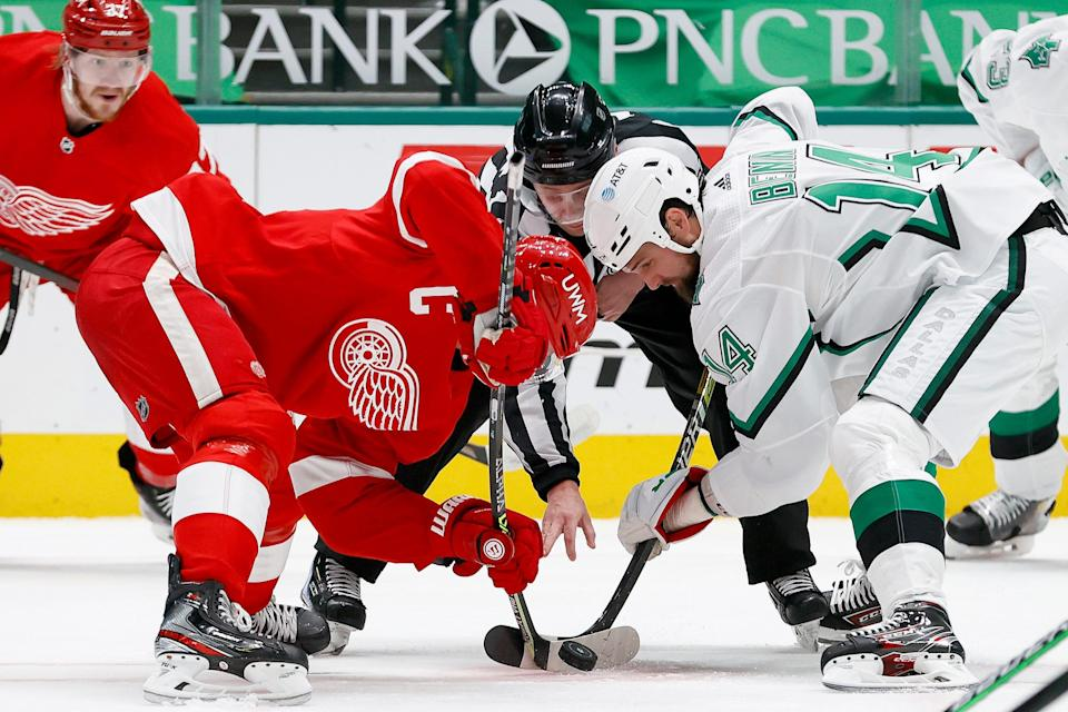 Red Wings forward Dylan Larkin faces off against the Stars' Jamie Benn in the first period on Monday, April 19, 2021, in Dallas.