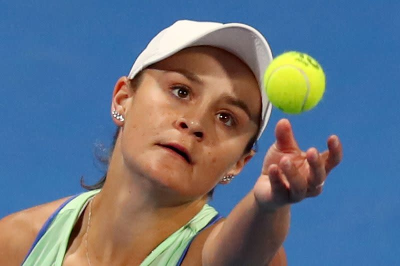 Barty trades racket for golf club but still a champion
