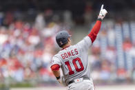 Washington Nationals' Yan Gomes gestures as he runs the bases after hitting a two-run home run during the seventh inning of a baseball game against the Philadelphia Phillies, Thursday, July 29, 2021, in Philadelphia in the first game of a double header. (AP Photo/Laurence Kesterson)