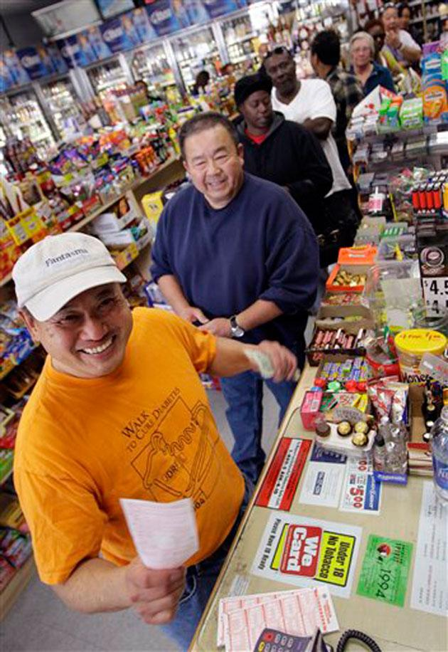 Shoppers wait in line for lottery tickets for the $540 million Mega Millions. AP