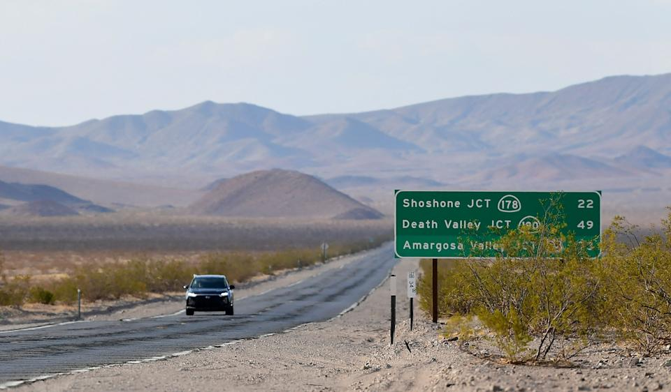 A vehicle drives through Death Valley, California, on July 11, 2021 as California where temperatures hit 120 degrees this weekend  as California is gripped in another heatwave. - Millions of people across the western United States and Canada were hit July 11, 2021, by a new round of scorching hot temperatures, with some roads closed, train traffic limited and new evacuations ordered. (Photo by Frederic J. BROWN / AFP) (Photo by FREDERIC J. BROWN/AFP via Getty Images)