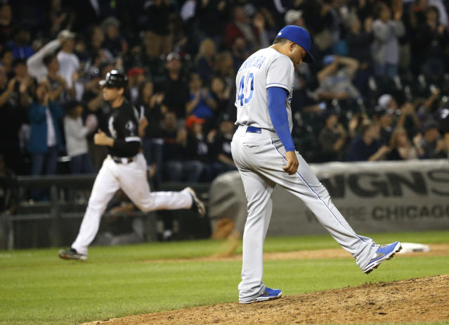 Kansas City Royals relief pitcher Kelvin Herrera, right, returns to the mound after giving up a home run to Chicago White Sox's Conor Gillaspie, left, during the eighth inning of a baseball game on Friday, July 26, 2013, in Chicago. (AP Photo/Charles Rex Arbogast)