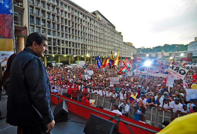 Venezuelan President Nicolas Maduro prepares to speak during a rally in front of the National Electoral Council in Caracas on October 26, 2015