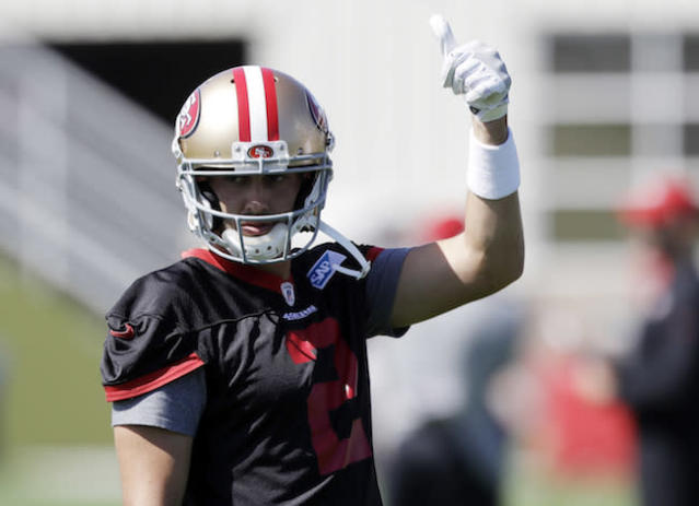 """For the deep league crowd, Liz Loza gives <a class=""""link rapid-noclick-resp"""" href=""""/nfl/players/9547/"""" data-ylk=""""slk:Brian Hoyer"""">Brian Hoyer</a> a thumbs up. (AP)"""