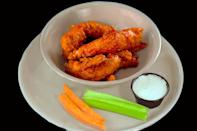 """<p>Miller's Ale House has its own take on boneless chicken wings, called """"Zingers,"""" and <a href=""""https://www.bizjournals.com/columbus/blog/2013/11/millers-ale-house-brings-expansive.html"""" rel=""""nofollow noopener"""" target=""""_blank"""" data-ylk=""""slk:people can't get enough of them"""" class=""""link rapid-noclick-resp"""">people can't get enough of them</a>. These juicy chicken tenders are fried to a perfect level of crispiness and can come in a wide variety of sauces. There's mild, medium and hot, plus garlic, honey, teriyaki, honey mustard, Caribbean jerk, hot garlic, sweet Thai chili, sriracha BBQ, Korean BBQ, mango habanero, honey lime sriracha, """"Mt. St. Helen's"""" and """"5 Pepper Fire."""" Zingers are such a top seller that Miller's also spun them into other items, like the Zingers Melt sandwich, and the Zingers Mountain Melt, Zingers with cheese and bacon on a """"<a href=""""https://millersalehouse.com/menu/"""" rel=""""nofollow noopener"""" target=""""_blank"""" data-ylk=""""slk:mountain of seasoned fries"""" class=""""link rapid-noclick-resp"""">mountain of seasoned fries</a>.""""</p>"""