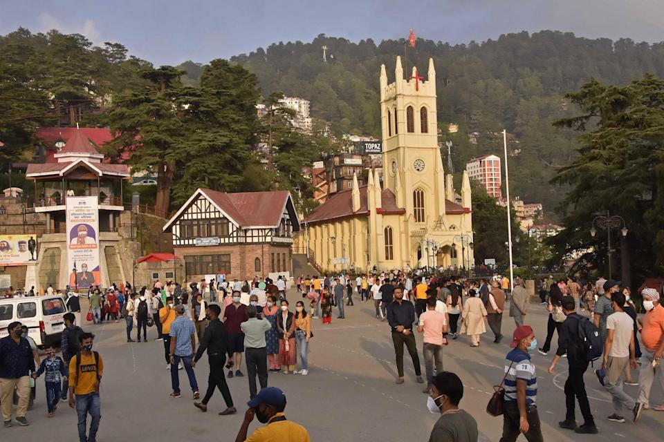Tourists around the ridge area of Shimla in India's Himachal Pradesh state on 6 July, 2021 (AFP via Getty Images)