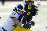 Michigan State linebacker Chase Kline (21) tackles Michigan wide receiver Giles Jackson (0) during the first half of an NCAA college football game, Saturday, Oct. 31, 2020, in Ann Arbor, Mich. (AP Photo/Carlos Osorio)