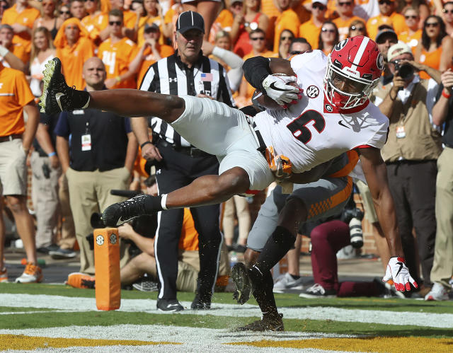 "Georgia wide receiver Javon Wims catches a touchdown pass over Tennessee defensive back <a class=""link rapid-noclick-resp"" href=""/ncaaf/players/226873/"" data-ylk=""slk:Shaq Wiggins"">Shaq Wiggins</a> during the first half an <a href=""https://sports.yahoo.com/college-football/"" data-ylk=""slk:NCAA college football"" class=""link rapid-noclick-resp"">NCAA college football</a> game against Tennessee on Saturday, Sept. 30, 2017, in Knoxville, Tenn. (Curtis Compton/Atlanta Journal-Constitution via AP)"