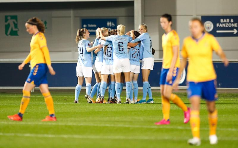 Rose Lavelle of Manchester City celebrates with teammates after scoring the equalising goal to make the score 1-1 during the FA Women's Continental League Cup match between Manchester City and Everton at Manchester City Football Academy on October 07, 2020 in Manchester, England. - GETTY IMAGES
