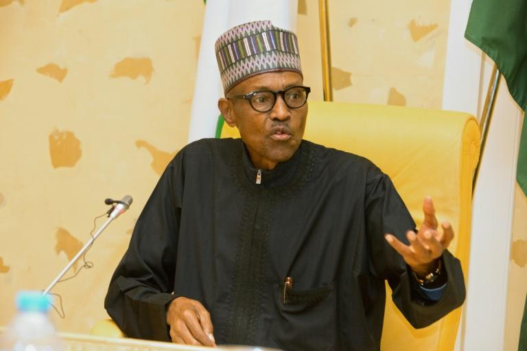 Nigerian President Muhammadu Buhari addresses members of his cabinet in March after returning from London where he underwent  treatment for nearly two months for an undisclosed ailment