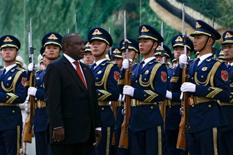 South Africa's President Cyril Ramaphosa reviews an honour guard at the Great Hall of the People