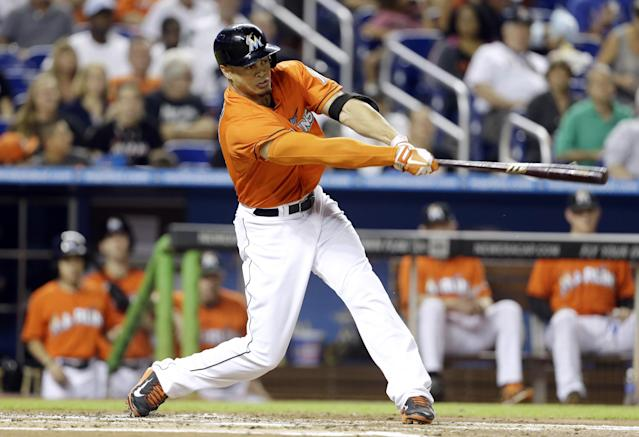Miami Marlins' Giancarlo Stanton hits an RBI single in the first inning of a baseball game against the Atlanta Braves, Wednesday, Sept. 11, 2013, in Miami. (AP Photo/Lynne Sladky)
