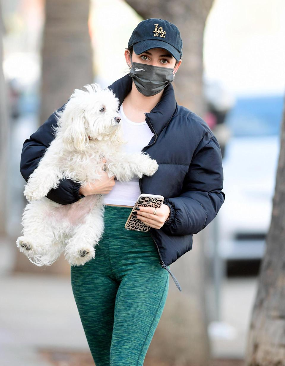 <p>Lucy Hale steps out in L.A. on Tuesday, wearing a baseball cap, leggings and a puffer coat, as her dog Elvis comes along for the ride.</p>