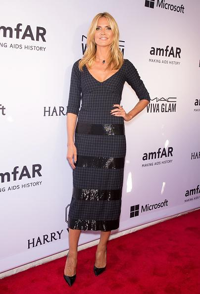 Heidi Klum was uncharacteristically covered up in a mid-length black dress. Usually one to flaunt her legs and show a lot of skin, the more demure look was a welcome red carpet switch up — she still looks hot!