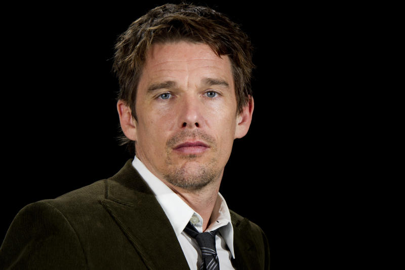 "This June 11, 2012 photo shows actor Ethan Hawke in New York. Hawke portrays a frustrated American writer who moves to Paris to be closer to his young daughter in ""The Woman in the Fifth.""   (Photo by Charles Sykes/Invision/AP)"