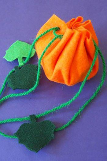 """<p>With just a few supplies and stitches required, this felt pumpkin bag is the perfect introduction to sewing.</p><p><strong>Get the tutorial at <a href=""""https://www.hellowonderful.co/post/EASY-PUMPKIN-TREAT-BAG-KIDS-WILL-LOVE-TO-MAKE/#_a5y_p=5851882"""" rel=""""nofollow noopener"""" target=""""_blank"""" data-ylk=""""slk:Hello, Wonderful"""" class=""""link rapid-noclick-resp"""">Hello, Wonderful</a>.</strong> </p>"""