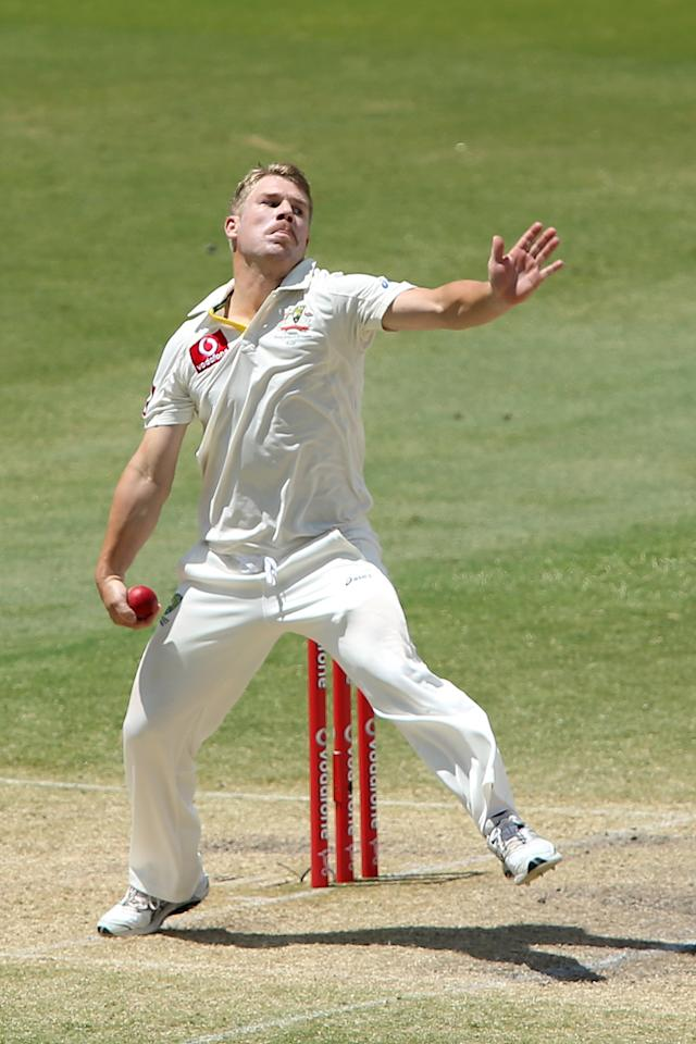 ADELAIDE, AUSTRALIA - NOVEMBER 26:  David Warner of Australia bowls during day five of the Second Test Match between Australia and South Africa at Adelaide Oval on November 26, 2012 in Adelaide, Australia.  (Photo by Morne de Klerk/Getty Images)