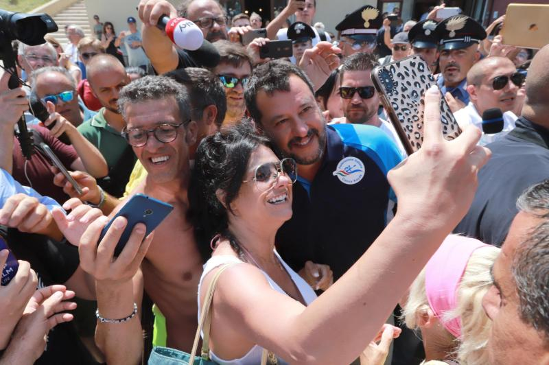 FILE - In this Aug. 9 2019 file photo Italian Deputy Prime Minister and Interior Minister, Matteo Salvini, poses for selfies with his supporters at Lido Cala Sveva in Termoli, southern Italy, part of his 'Italian summer tour'. Both Italian right-wing leader Matteo Salvini and British Prime Minister Boris Johnson  found themselves in political corners this week, each in his own way having lost bets that their popularity would carry the day.(Nico Lanese/ANSA via AP)