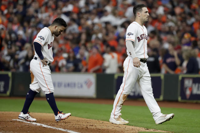 Houston Astros' Jose Altuve, left, and Alex Bregman walk to the dugout after a double play ends the seventh inning in Game 1 of baseball's American League Championship Series against the New York Yankees Saturday, Oct. 12, 2019, in Houston. (AP Photo/Eric Gay)