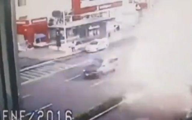 The explosion sent debrise flying across a busy road during the morning rush hour.