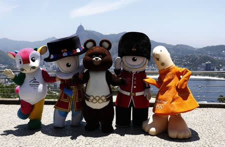 Mascots from other editions of the Summer Olympic Games (L-R) Fu Niu Lele (Beijing 2008), Wenlock (London 2012), Misha (Moscow 1980), Mandeville (London 2012) and Athena (Athens 2004) pose for a picture on top of Sugar Loaf mountain in Rio de Janeiro November 21, 2014. REUTERS/Sergio Moraes