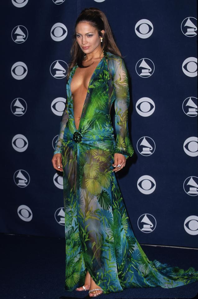 <p>Sporting a plunging neckline, this slik chiffon Versace dress had people talking. This red carpet moment set the tone for the performer, hailing her the queen of the barely-there trend. [Photo: Getty] </p>