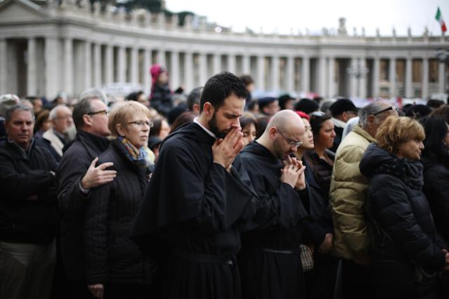 VATICAN CITY, VATICAN - MARCH 17: Priests pray in St Peter's Square as Pope Francis gives his first Angelus blessing on March 17, 2013 in Vatican City, Vatican. The Vatican is preparing for the inauguration of Pope Francis on March 19, 2013 in St Peter's Square. (Photo by Peter Macdiarmid/Getty Images)
