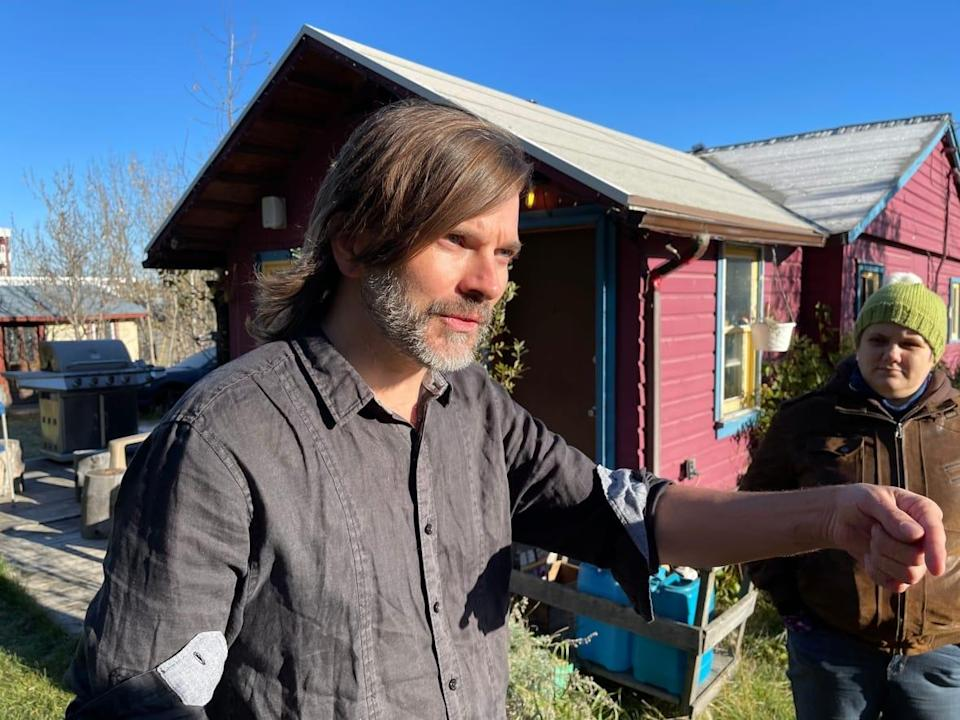 Eric DeLong has lived in a purple house in downtown Whitehorse for about the last four years. Now, he's fighting for the lease for the land the home sits on to be renewed, after the Yukon government recently said it has expired. ( Wayne Vallevand/CBC - image credit)